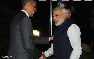 PM_Modi_and_President_Obama_shaking_hands.jpg
