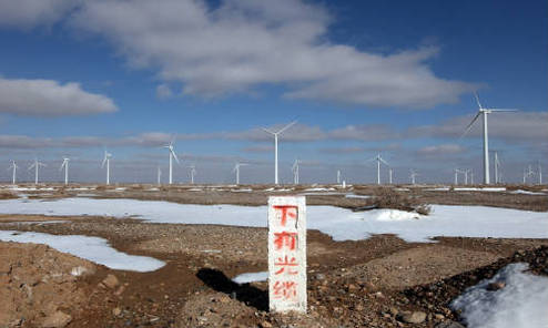 """Optical Cables Below"" reads a sign outside a wind farm in Yumen, Gansu province"