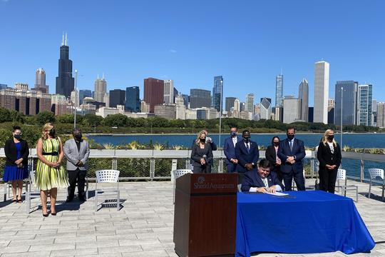 Illinois Governor JB Pritzker signing the Climate and Equitable Jobs Act