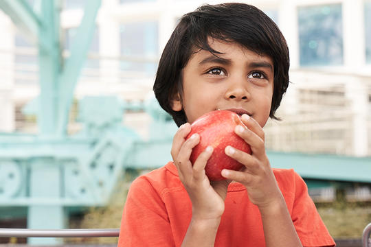 Child eating fruit, chlorpyrifos