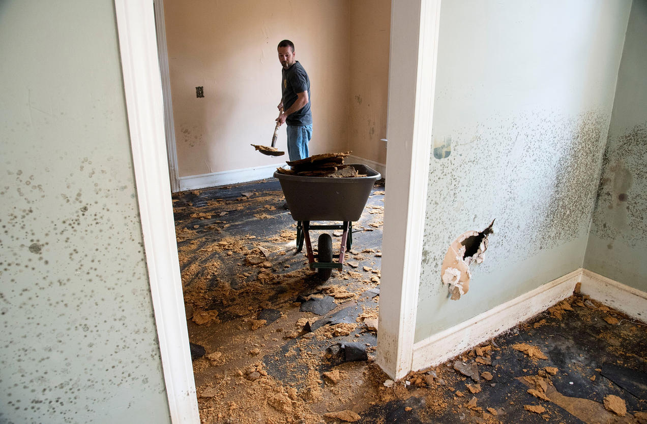 B Davis Cleans Out A Home Heavily Damaged By Hurricane Matthew Floodwaters In Nichols South Carolina As Toxic Black Mold Grew Rampant