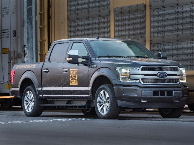Electric Ford F-150 Towing Freight Train