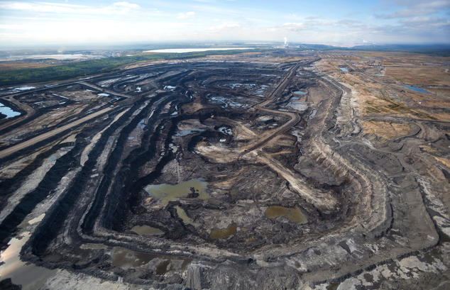 How is oil extracted from tar sands?