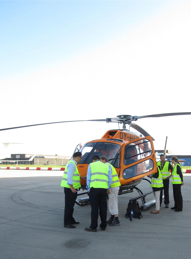 Researchers explaining how chemical sensors (attached to the front of the helicopter) are used to measure air pollutants from ships as the helicopter flies into ship exhaust plumes near the Port of Rotterdam