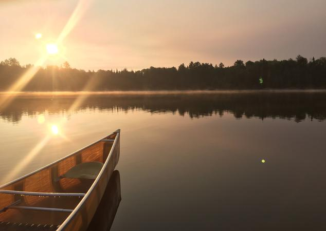 Canoe on the Boundary Waters in a Foggy Sunrise