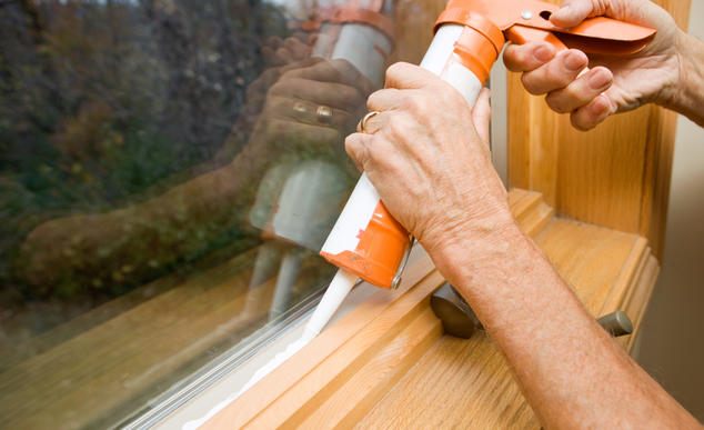 Applying weatherization to home window