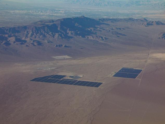 Solar power plants in Nevada with Las Vegas Strip in the background