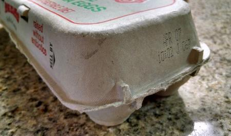 Image of egg carton with Sell by date label